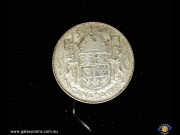 50 Cents. Crowned arm with supporters, date below. Elizabeth II. Reeded edge. (Please note that email offers are considered on all coins.) (*)