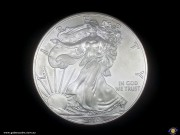 """$1. One oz. fine silver. Silver eagle. Liberty """"In God we trust"""". Bullion coin. (Please note that email offers are considered on all coins.)"""